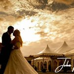 Minstrel Court Wedding Venue - Bride and Groom against a stunning Sky