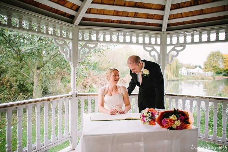 Minstrel Court lake Wedding Pavilion - Bride and Groom Signing the Register