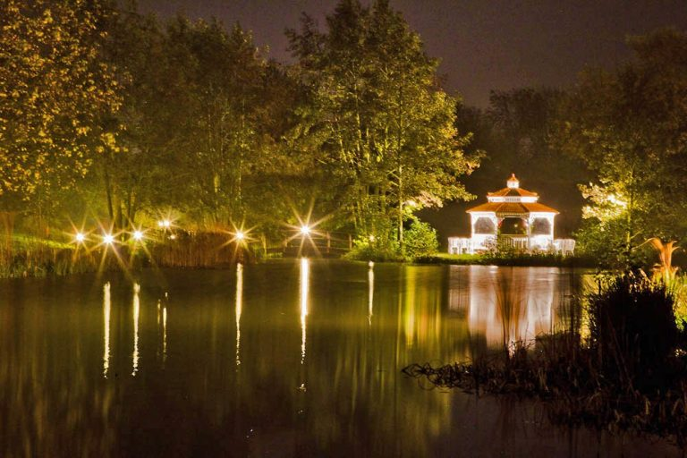 Minstrel Court lake Wedding Pavilion illuminated at night