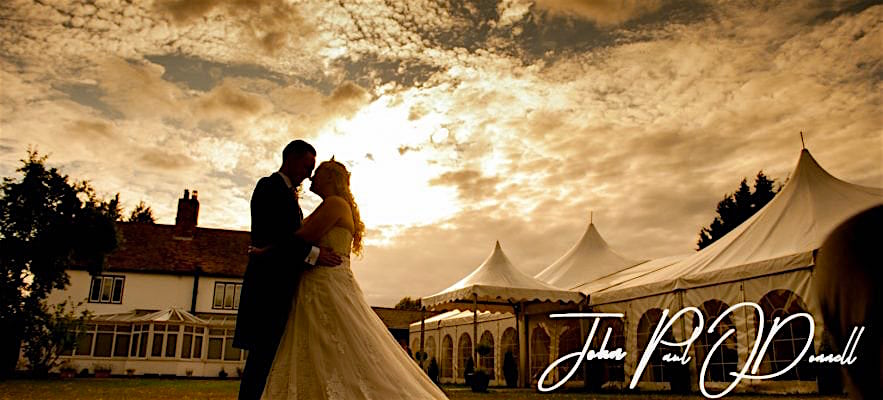 Minstrel Court Wedding Venue - Bride and Groom against a stunning Sky