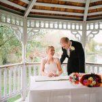 Minstrel Court lake Wedding Pavilion - Bride and Groom Signing the Register